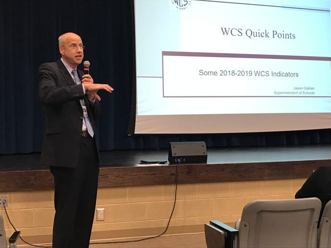 Williamson County Schools Superintendent Jason Golden delivers a presentation to parents at Centennial High School on Thursday.