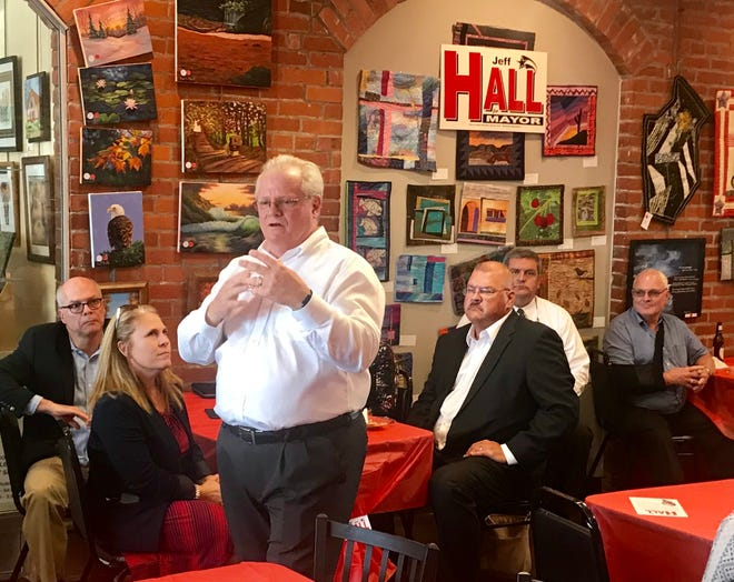 Newark Mayor Jeff Hall talks to supporters Thursday night at The Grill Works Deli in his first campaign event for the upcoming mayoral election.