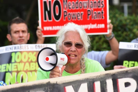 Paula Rogovin of the Coalition to Ban Oil Trains speaks as North Jersey community activists, environmentalists, local officials and statewide groups gather for a press conference before testify, at the Murphy Administration's public hearing on the DRAFT 2019 Energy Master Plan