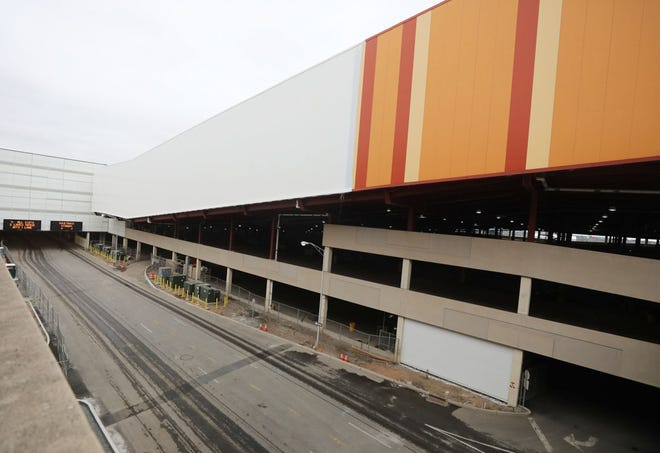 A portion of the ski slope at American Dream in the Meadowlands beginning to have a white coat of paint cover itÕs old stripes that have been decorating the structure for many years.
