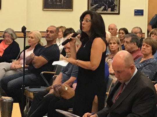 Mahwah resident Doreen Entrup testifies in favor of a cell tower to correct a dead zone in her neighborhood, where she was attacked by a coyote and unable to call for help from her cell phone.