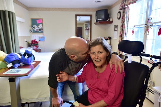 Glenn Prettitore kissed his wife, Kerrie, in this photo from 2016. The 44-year-old mother of three was in a minimally conscious state, two years after receiving a single chemotherapy treatment with 5-FU to treat colon cancer. Unknown to her at that time, she had a genetic condition called DPD deficiency that led to a toxic reaction to the drug. Kerrie died in July 2018.