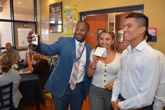 New Mexico Secretary of Education Ryan Stewart grabs a selfie with Myrka Anchondo, center, and Jose Abril, right, students in the Gadsden High School culinary arts program on Thursday, Sept. 5, 2019. In the background, but not  visible in this photo, is student Flor Garcia.