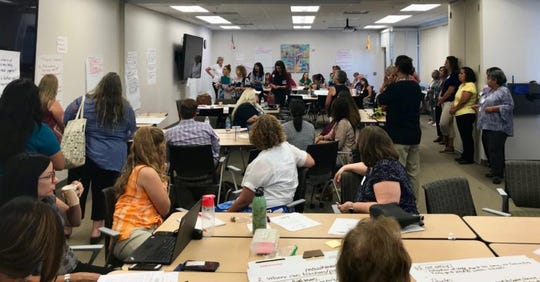 A large group gathers to talk about what is working — and not — in early childhood programs in New Mexico on Wednesday, Sept. 4, 2019, at Las Cruces City Hall. There were so many participants, the community gathering moved into a second room.