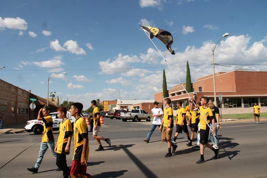 Alamogordo High School soccer players march in the AHS football homecoming parade Sept. 6.
