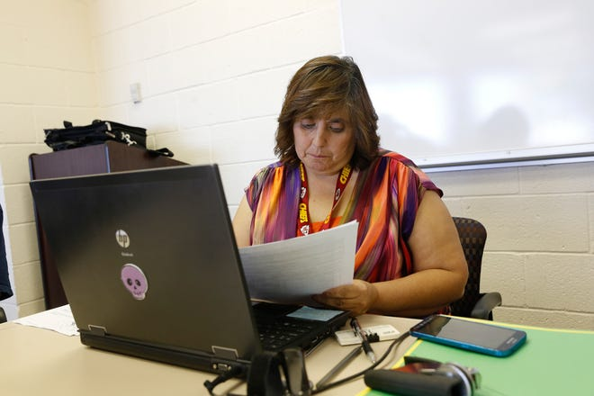 State of New Mexico Registrar Renee Valencia enters information on her computer on Sept. 22, 2016 at the Northern Navajo Agency Nataani Nez Complex in Shiprock.