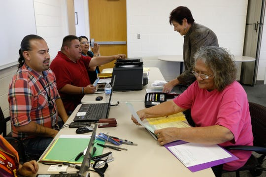 State of New Mexico officials and volunteers help Betty Largo, right, with her birth certificate paper work on Sept. 22, 2016 at the Northern Navajo Agency Nataani Nez Complex in Shiprock.