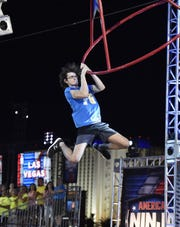 Philip Scott is in his element on the swinging obstacles on 'American Ninja Warrior' courses.