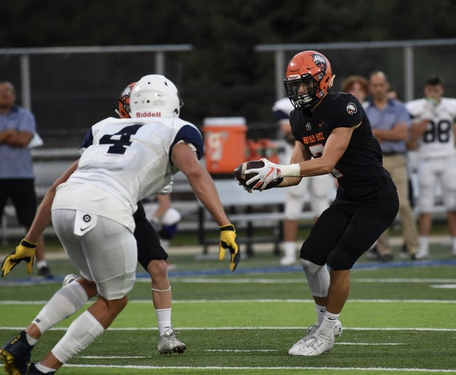 Brother Rice wide reciever/safety Rocco Milia plays wildcat quarterback in a game against Windsor Holy Names on Sept. 5.