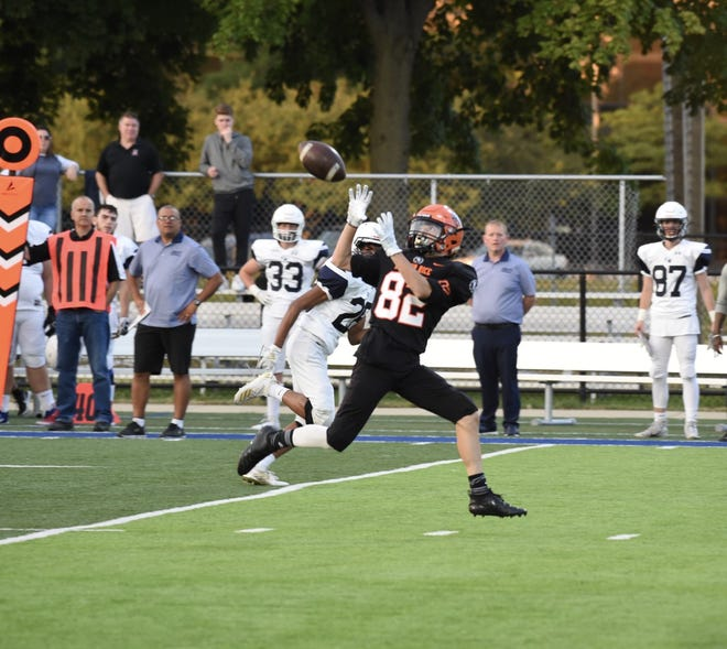 Brother Rice wide receiver Cole Lacanaria catches a touchdown pass in a game against Windsor Holy Names on Sept. 5.