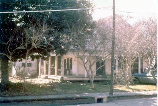 A view of the Perrodin/Prados House on Grolee Street, from Main to Union, where it stood for over 100 years. This photo was taken in 1968 by Huey Bourque who was director of the Chamber of Commerce at that time. The home was demolished shortly after that photo was taken. Today the Opelousas Library sits on the old Perrodin property.