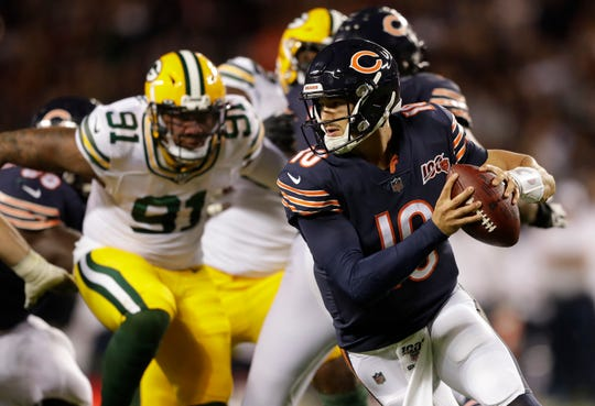 Chicago Bears quarterback Mitchell Trubisky looks to pass against as Preston Smith closes in during Thursday's game at Soldier Field in Chicago.