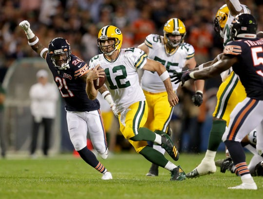 Green Bay quarterback Aaron Rodgers scrambles during the second half of the Packers' 10-3 win over the Chicago Bears at Soldier Field this season.