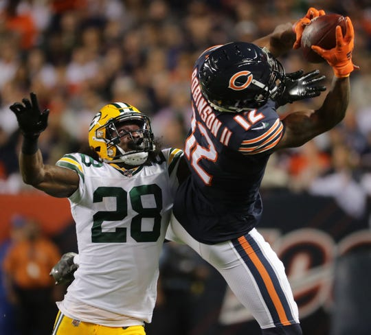 Chicago Bears wide receiver Allen Robinson (12) reels in a 27-yard reception while being covered by Green Bay Packers defensive back Tony Brown (28) during the second quarter of their game Thursday, September 5, 2019 at Soldier Field in Chicago, Ill.MARK HOFFMAN/MILWAUKEE JOURNAL SENTINEL