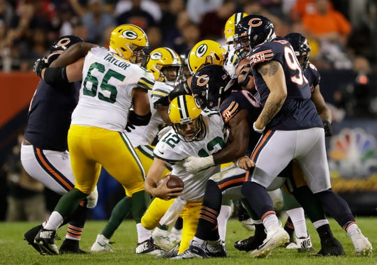 Green Bay Packers quarterback Aaron Rodgers (12) is sacked by Chicago Bears outside linebacker Leonard Floyd (94) in the third quarter Thursday, September 5, 2019, at Soldier Field in Chicago, Ill. Dan Powers/USA TODAY NETWORK-Wisconsin