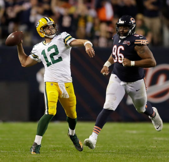 Packers quarterback Aaron Rodgers throws a long pass against the Bears in the season opener Sept. 5 at Soldier Field, as Bears defensive tackle Akiem Hicks pursues.