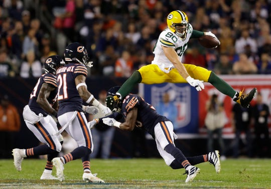 Green Bay Packers tight end Jimmy Graham (80) hurdles Chicago Bears free safety Eddie Jackson (39) late in the second quarter as inside linebacker Danny Trevathan (59) and strong safety Ha Ha Clinton-Dix (21) move in on the play Thursday, September 5, 2019, at Soldier Field in Chicago, Ill. 