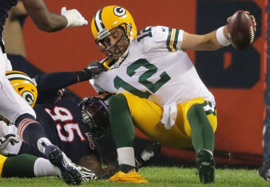 Green Bay Packers' Aaron Rodgers (12) is sacked by Chicago Bears defensive end Roy Robertson-Harris (95) quarter of their game Thursday, September 5, 2019 at Soldier Field in Chicago, Ill.