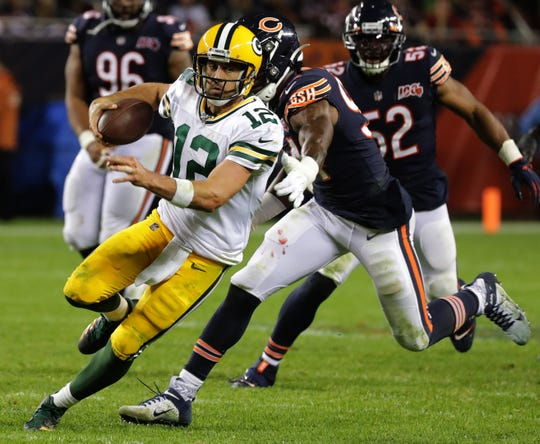 Green Bay Packers' Aaron Rodgers (12) runs for 10-yards during the fourth quarter of their game Thursday, September 5, 2019 at Soldier Field in Chicago, Ill. The Green Bay Packers beat the Chicago Bears 10-3.