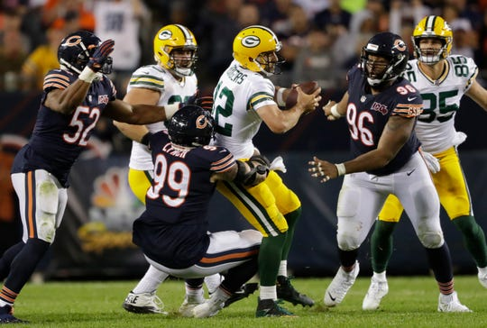 Green Bay Packers quarterback Aaron Rodgers (12) is sacked by Chicago Bears outside linebacker Aaron Lynch (99) in the second half Thursday, September 5, 2019, at Soldier Field in Chicago, Ill. 