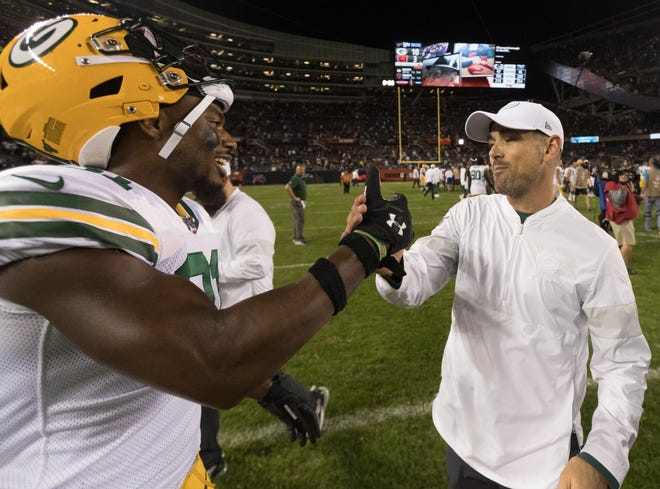 Packers head coach Matt LaFleur is congratulated by strong safety Adrian Amos (31) after the season-opening win at Soldier Field.