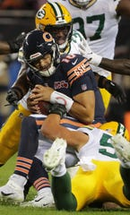 Chicago Bears quarterback Mitchell Trubisky (10) is sacked by Green Bay Packers inside linebacker Blake Martinez (50) and strong safety Adrian Amos (31) during the second quarter of their game Thursday, September 5, 2019 at Soldier Field in Chicago, Ill.    MARK HOFFMAN/MILWAUKEE JOURNAL SENTINEL