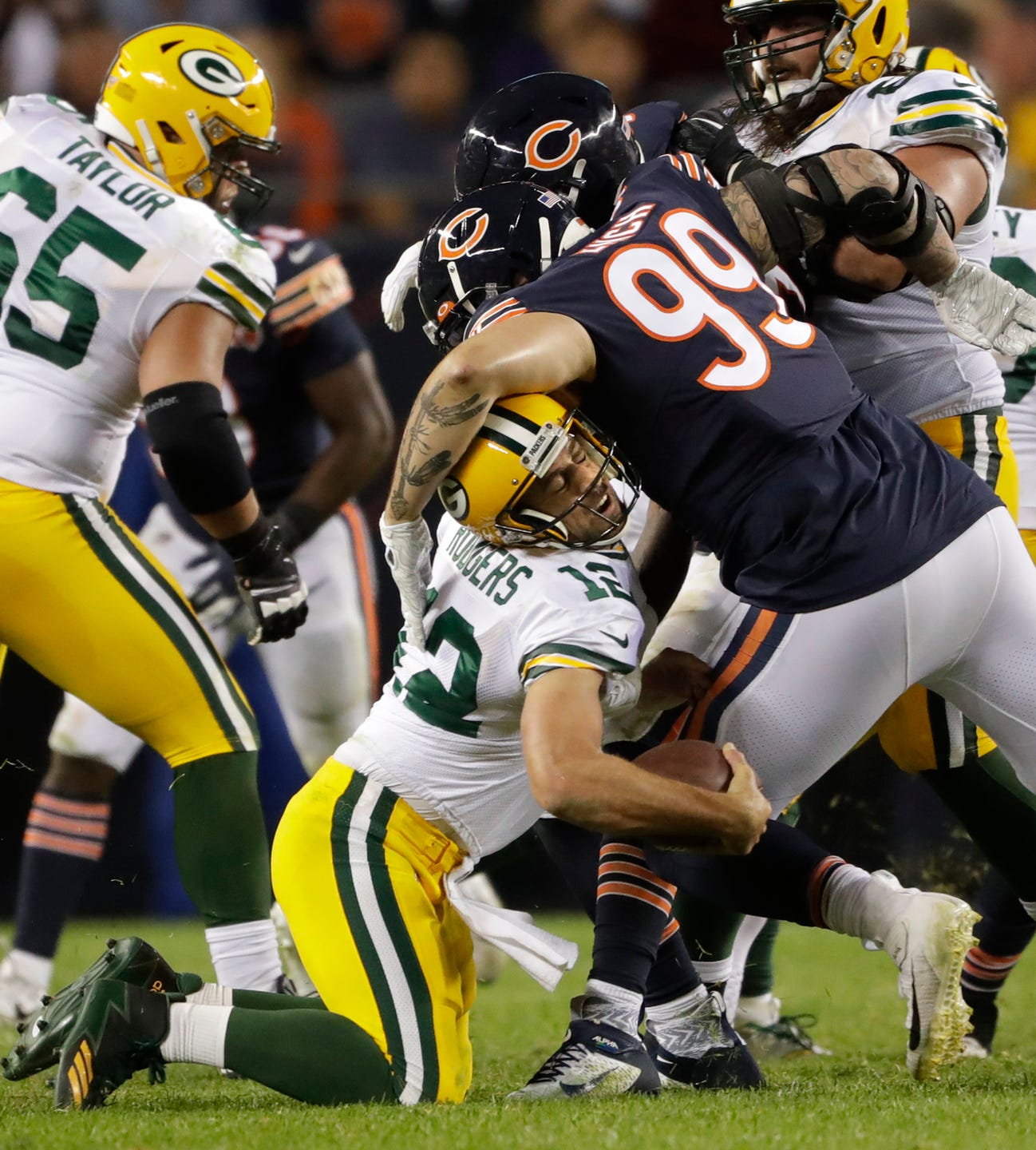 Green Bay Packers quarterback Aaron Rodgers (12) is sacked by Chicago Bears outside linebacker Leonard Floyd (94) and hit by outside linebacker Aaron Lynch (99) in the third quarter Thursday, September 5, 2019, at Soldier Field in Chicago, Ill.  Dan Powers/USA TODAY NETWORK-Wisconsin