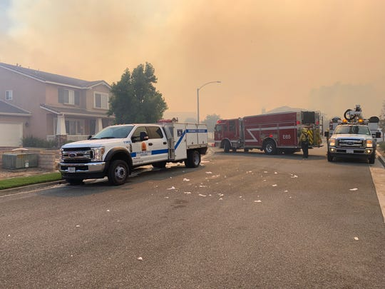 Three different firefighting agencies had trucks on Single Oak Way in the Copper Canyon neighborhood of Murrieta. The privately contracted firefighters hired by insurance companies to protect their policyholders' homes worked together with government agencies, and even helped to protect neighboring homes that weren't theirs, on Sept. 5, 2019.