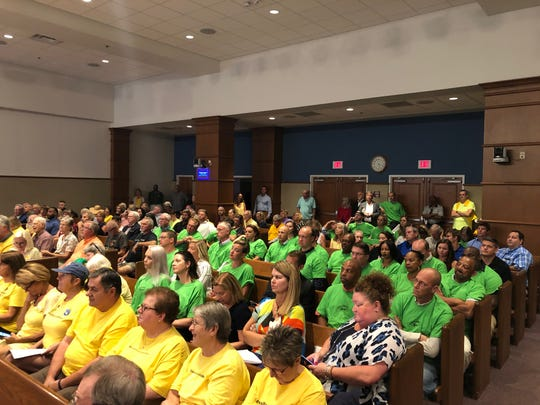 Members of Pensacola Beach's hospitality industry packed the Escambia County Commission chambers wearing green shirts to call on the county to fund the construction of beach roundabouts.