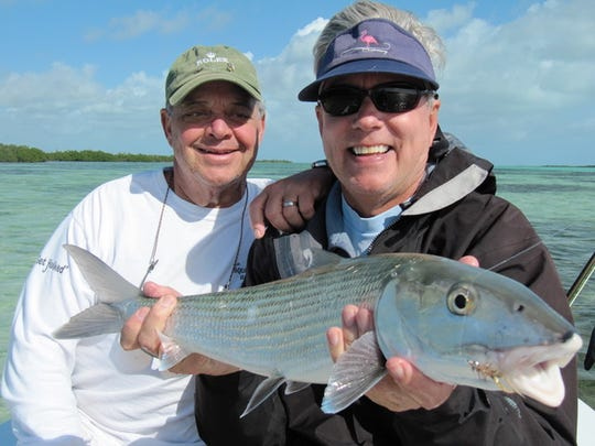Pensacola's Corbett Davis Jr. attests that renown author Carl Hiaasen is as skilled at fishing as he is at writing.