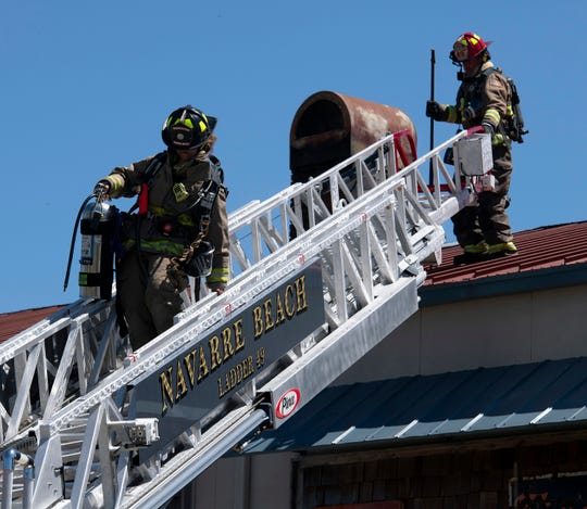 Navarre Beach Fire Rescue firefighters respond Friday to a call at the East River Smokehouse on Navarre Parkway. Voters will decide next month whether or not to create a special fire district so Navarre Beach firefighters can receive state retirement benefits.