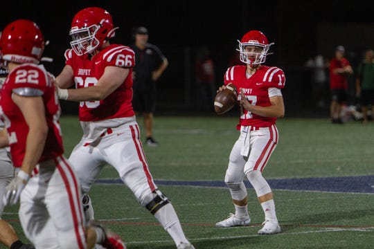 Brophy quarterback Elijah Warner looks for a pass during a scrimmage held at Pinnacle High School on Aug. 15, 2019.