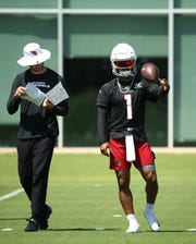 Cardinals coach Kliff Kingsbury and quarterback Kyler Murray during practice Monday in Tempe, Ariz.