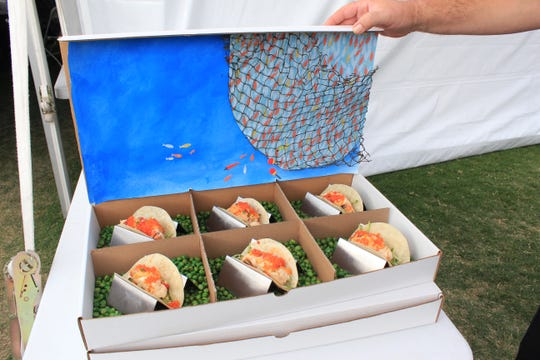 During the Arizona Taco Festival, teams create different varieties of tacos.