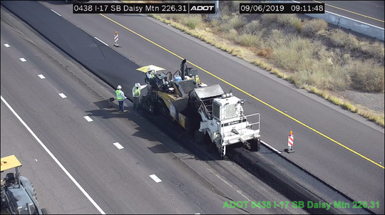 Crews lay down new asphalt on south Interstate 17 near Daisy Mountain Drive in the Anthem area on Friday, Sept. 6, 2019. Lane closures in effect from 5 a.m. to 10 p.m.