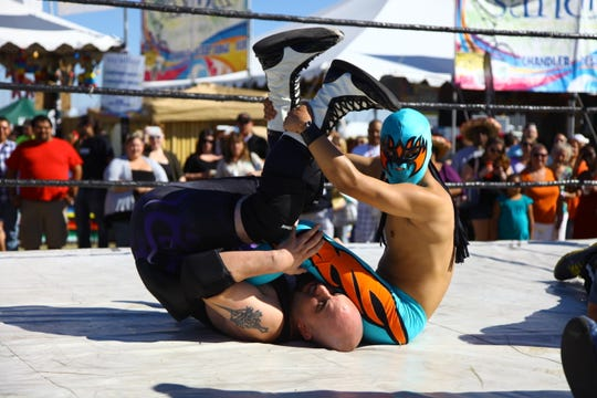 The Arizona Taco Festival has activities such as lucha libre wrestling.