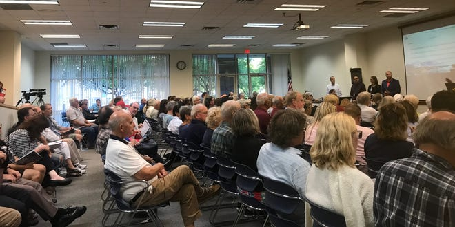A packed house listens into an informational meeting on high water levels Thursday, Sept. 5, 2019, at the Dodge Auditorium of the St. Clair County administration building in Port Huron.