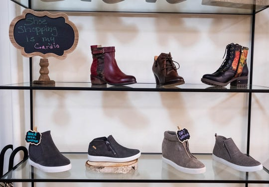 Shoes line different racks inside District 43 in downtown Port Huron. The store, which is opening Saturday, offers a variety of casual, business and evening shoes, as well as flip-flops and rain boots and some kids shoes.