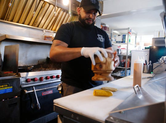 Café Con Leche owner Phil Cordero prepares tostones, Puerto Rican fried plantains at the cafe in New Hamburg on September 6, 2019.