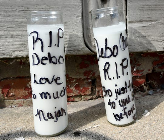 Memorial candles were placed on the sidewalk near where a fatal shooting occurred on North Pine Street Friday, Sept. 6, 2019. Bill Kalina photo