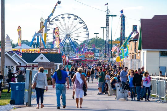 In a scene from the York Fair this year, the ferris wheel in the background is also known as the Giant Wheel. This is where two injuries are reported to have occurred Friday evening.