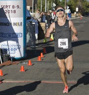 Tyler Sickler crosses the finish line to win the 50th Annual Journal Jog in Reno, Nevada on Sept 9, 2018.