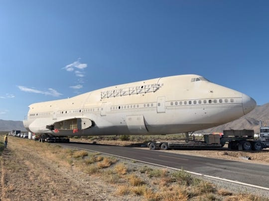 The 747 aircraft fuselage turned Burning Man art car being trucked down State Route 34 on Friday, Sept. 6.