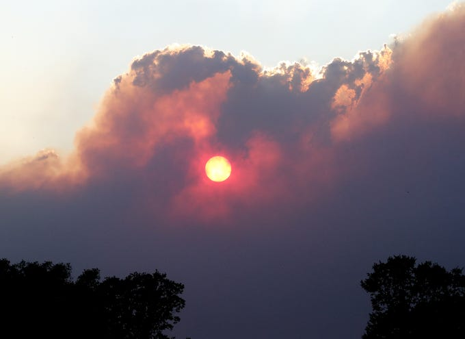 The sun sets through smoke clouds from the Red Bank Fire west of Red Bluff on Sept. 5, 2019.