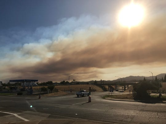 Smoke from the Red Bank Fire outside of Red Bluff stretches into north Redding.