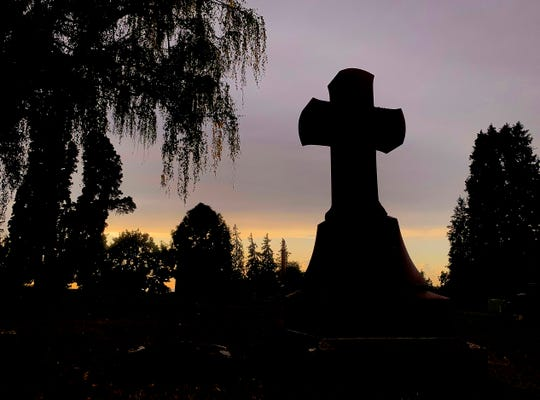 The sun sets over the City View Cemetery in Salem, Oregon, September 5, 2019.