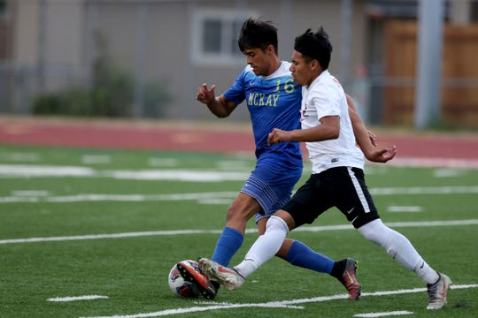 McKay's Luis Cuellar (16) and North Salem's Nathan Martinez Sanchez (9) chase after the ball in the North Salem vs. McKay boys soccer game at McKay High School in Salem on Sep. 5, 2019. McKay won the game 3-0.