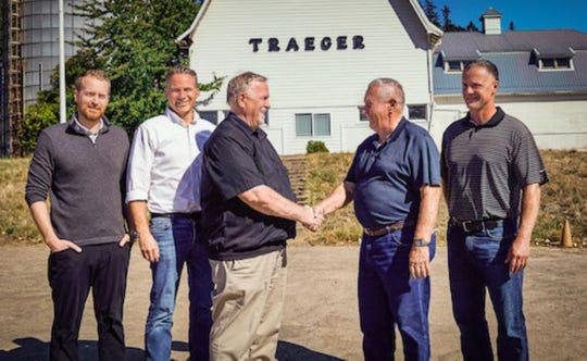 An exhibit to the lawsuit filed in Arizona is a photo of Jordan Thiessen (from left), Jeff Thiessen, Dan Thiessen, Joe Traeger and Brian Traeger in front of the Traeger barn in Mt. Angel.