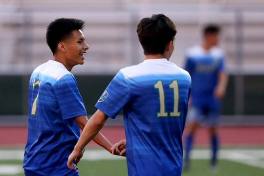 McKay's Bryan Lopez (7) and Cesar Gandara (11) high five during the North Salem vs. McKay boys soccer game at McKay High School in Salem on Sep. 5, 2019. McKay won the game 3-0.