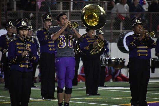 Salinas linebacker Damian Sampaga (30) performs with the Salinas High band at halftime. Sept. 5, 2019.